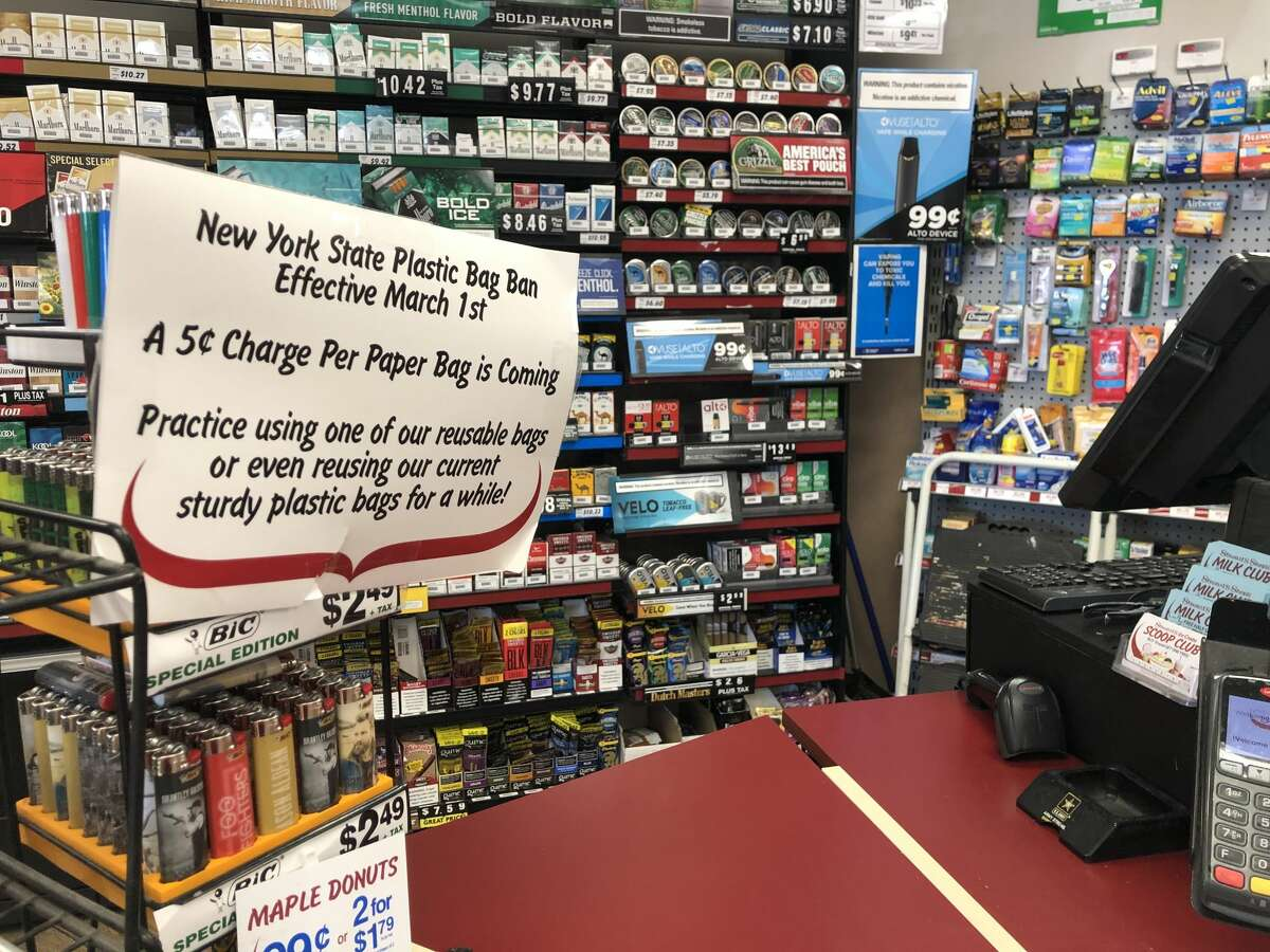 A sign at the Stewart's in Troy on Sunday, March 1, 2020, informs customers about a newly enacted paper bag fee.