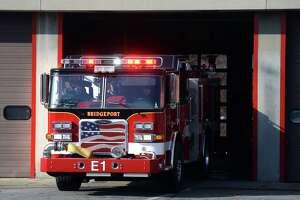 A Bridgeport Fire Department truck leaves headquarters in Bridgeport.