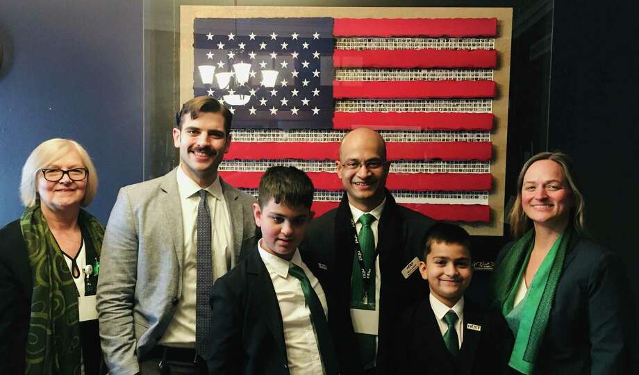 Ridgefield's Sarup family went to Washington DC to lobby for federal funds in the fight against Fragile X Syndrome. From left are grandmother Dottie Anastasia, Nicholas Larsen of Congressman Jim Himes' office, Jordan Sarup, Rajat Sarup, Ari Sarup and Stephanie Sarup. Photo: Contributed Photo