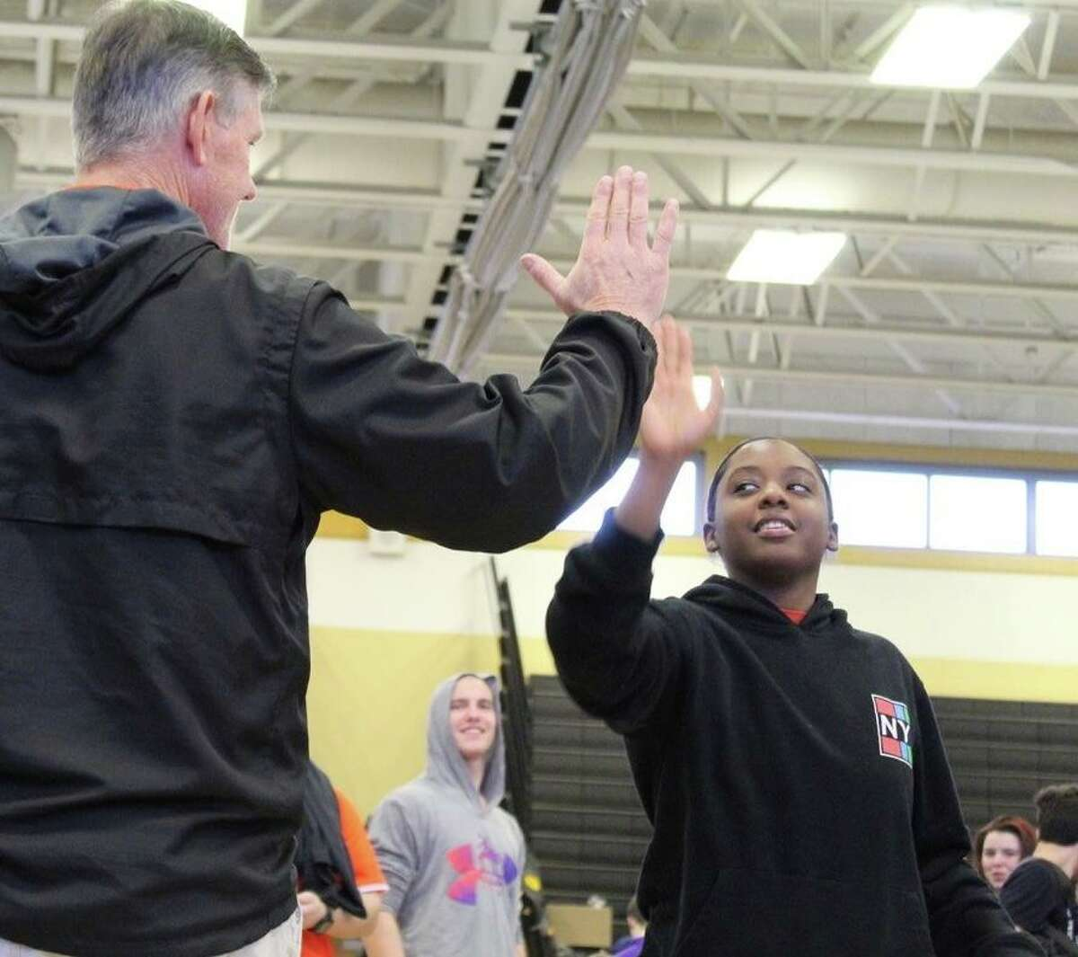 Anala Smith is greeted by Shelton wrestling coach Bill Maloney.