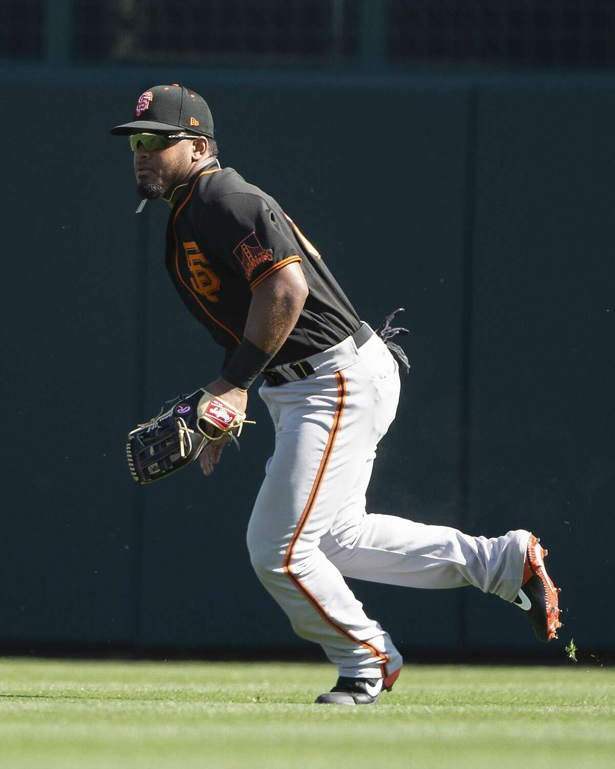 GLENDALE, ARIZONA - FEBRUARY 25: Heliot Ramos #80 of the San Francisco Giants fields against the Chicago White Sox on February 25, 2020 at Camelback Ranch in Glendale Arizona. ~~