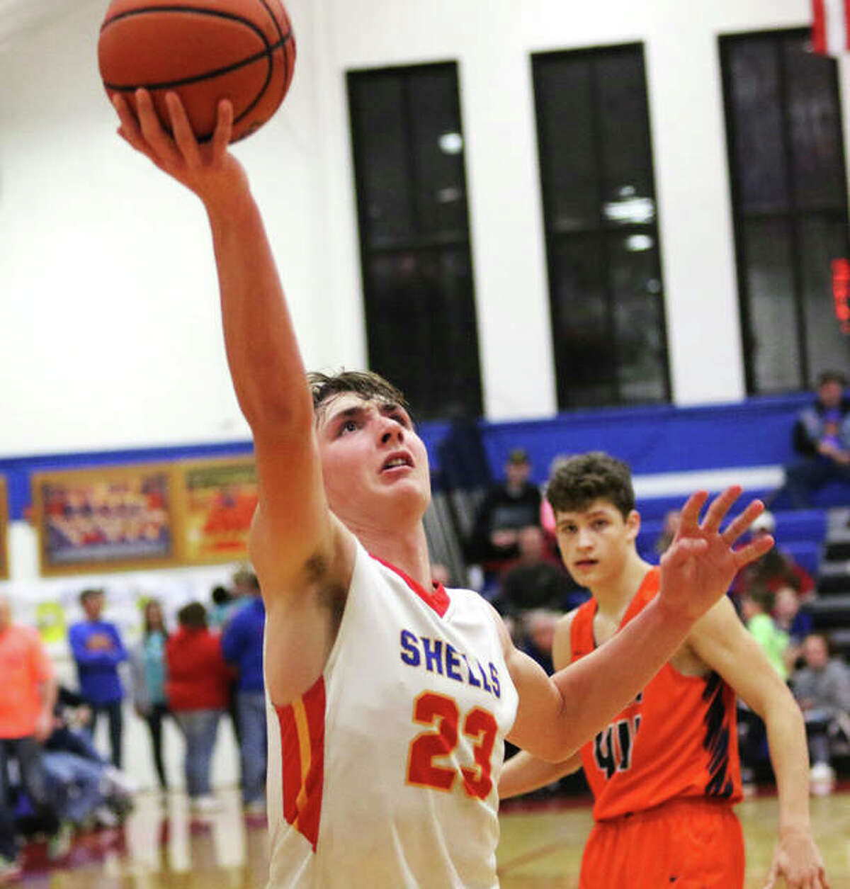 Roxana's Gavin Huffman gets to the basket to score in a SCC game vs. Pana on Feb. 11 at Milazzo Gym in Roxana.