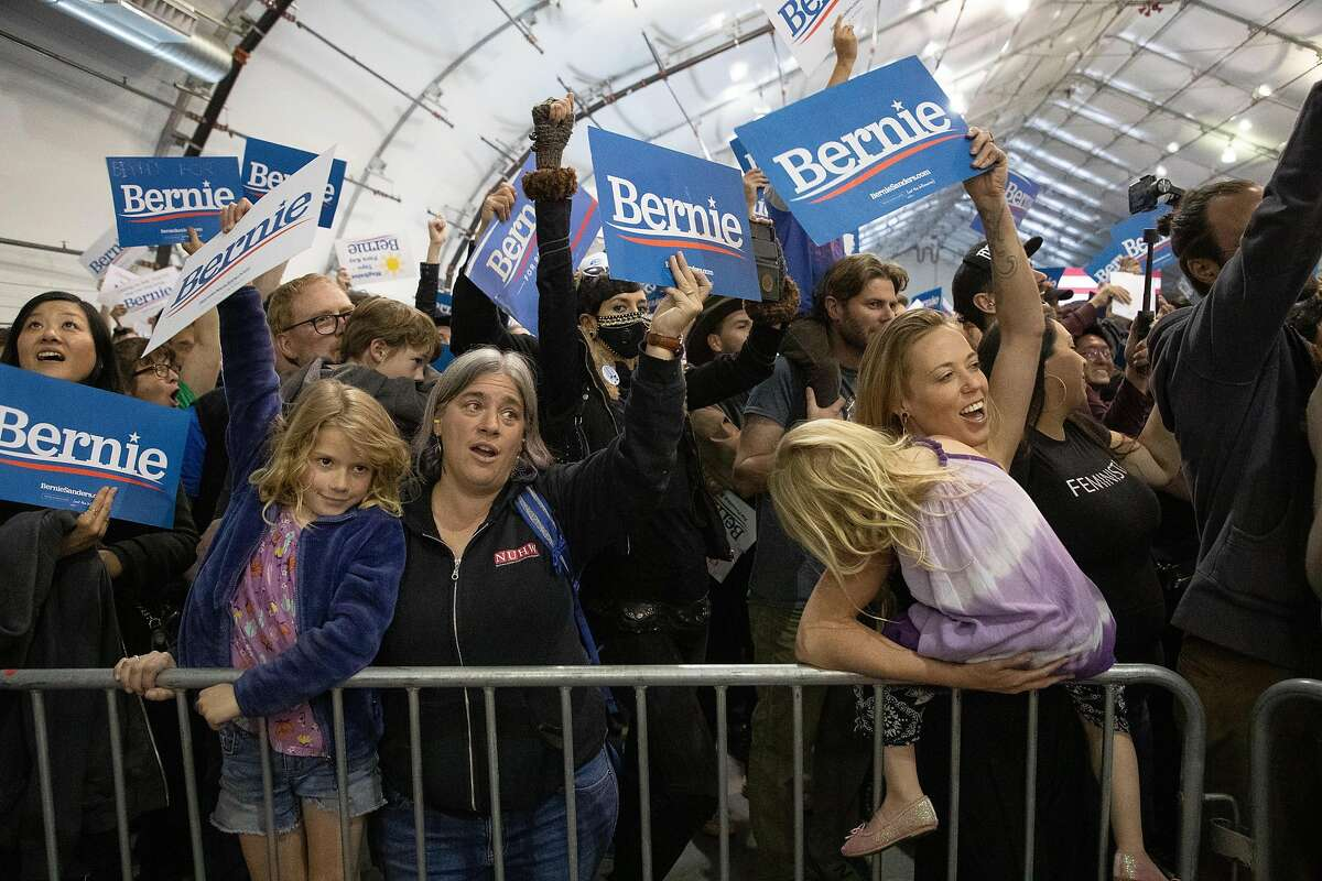 Supporters cheer as Bernie Sanders speaks to the crowd at McEnery Convention Center, South Hall, Sunday, March 1, 2020 in San Jose, Calif.