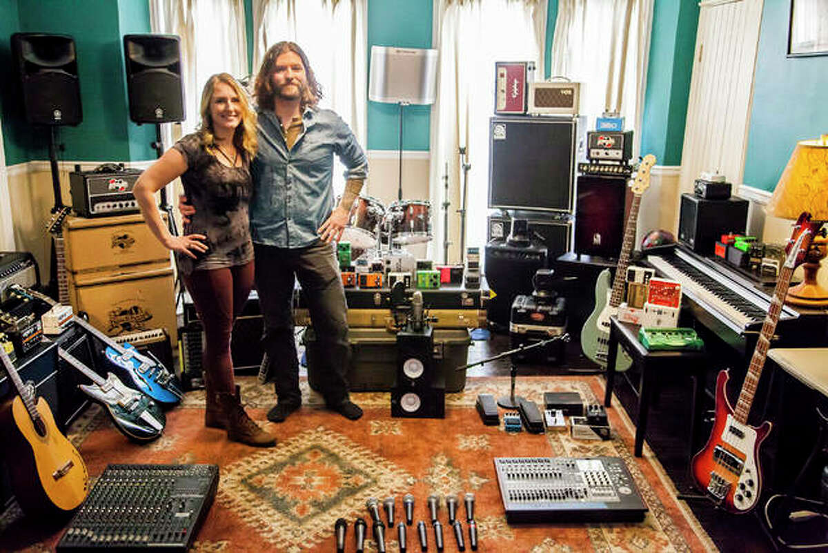 Jenny, left, and Jared Unfried at their home in Alton, getting ready to open their new music store, Alton Music Exchange, on East Broadway, in Alton.