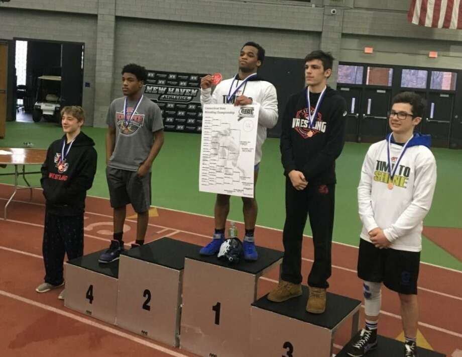 Kalil Shabazz, center, of Middletown High won a State Open wrestling championship at 126 pounds. Photo: Contributed Photo