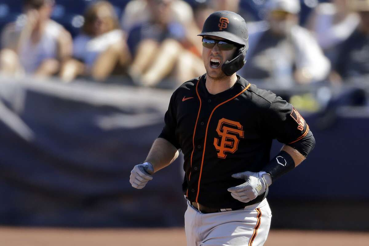 San Francisco Giants' Buster Posey runs the bases after hitting a two-run home run during the third inning of a spring training baseball game against the San Diego Padres Sunday, March 1, 2020, in Peoria, Ariz. (AP Photo/Charlie Riedel)