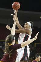 Stanford's Francesca Belibi (5) shoots against Arizona State's Lexie Hull (12) during the first half of an NCAA college basketball game Sunday, March 1, 2020, in Tempe, Ariz. (AP Photo/Darryl Webb)