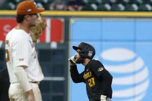Mizzou's Brandt Belk (21) reacts after hitting an RBI double in the ninth inning against Texas during an NCAA college baseball game at Minute Maid Park during the College Classic tournament, in Houston,Sunday, March 1, 2020.