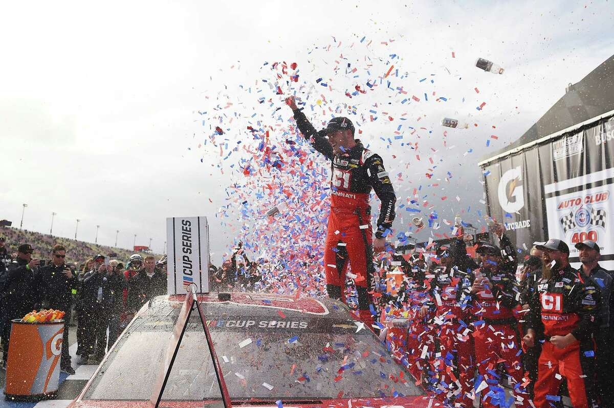FONTANA, CALIFORNIA - MARCH 01: Alex Bowman, driver of the #88 Cincinnati Chevrolet, celebrates in Victory Lane after winning the NASCAR Cup Series Auto Club 400 at Auto Club Speedway on March 01, 2020 in Fontana, California. (Photo by Stacy Revere/Getty Images)