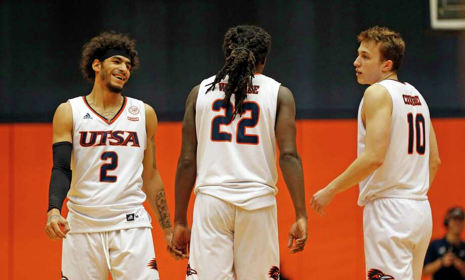 UTSA Jhivvan Jackson shares a light moment in closing seconds with Keaton Wallace and Erik Czumbel,10 on Sunday, March 1, 2020 at the Convocation Center. UTSA defeated UAB 66-59. Photo: Ronald Cortes/Contributor / 2020 Ronald Cortes