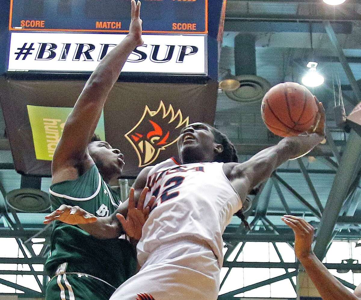 UAB Keaton Wallace drives on UAB Will Butler on Sunday, March 1, 2020 at the Convocation Center. UTSA defeated UAB 66-59.