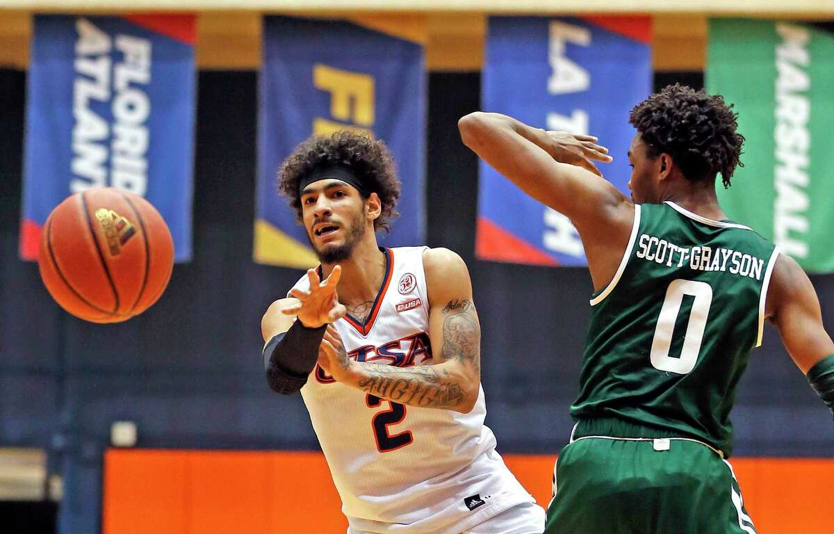 UTSA Jhivvan jacksonon passes to a teammate as he was guarded by UAB Tyreek Scott-Grayson on Sunday, March 1, 2020 at the Convocation Center. UTSA defeated UAB 66-59.