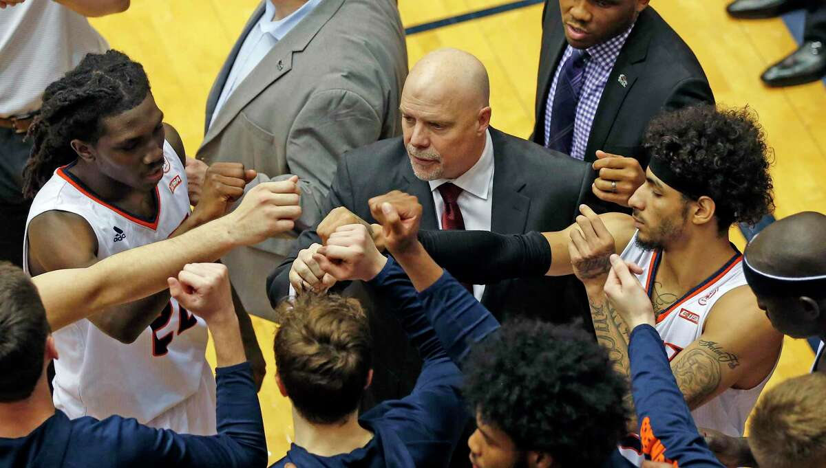 UTSA head coach Steve Henson joins his team during a time-out on Sunday, March 1, 2020 at the Convocation Center. UTSA defeated UAB 66-59.