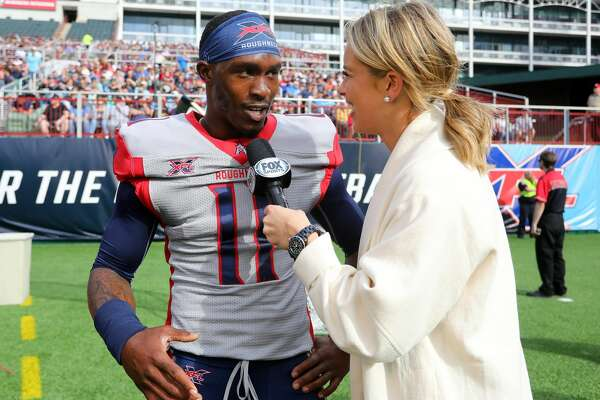 ARLINGTON, TEXAS - MARCH 01: P.J. Walker #11 of the Houston Roughnecks is interviewed by a FOX sideline reporter after a three-point conversion against the Dallas Renegades at an XFL football game on March 01, 2020 in Arlington, Texas. (Photo by Richard Rodriguez/Getty Images)