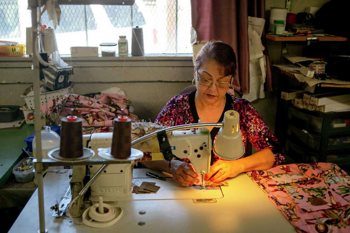 """Lety Garza sews at Fuerza Unida in San Antonio.""""If you like sewing, you put more enthusiasm (into the work) and you learn more,"""" Garza says."""