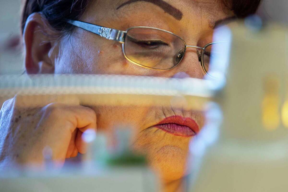 Lety Garza pauses her sewing on Feb. 26, 2020.