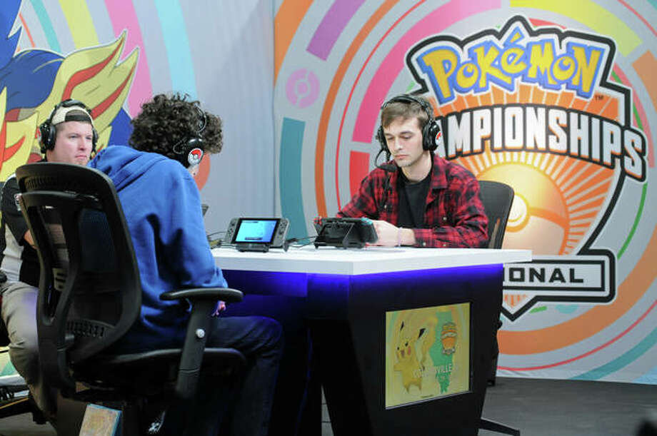 Two players face off on stage in front of the rest of the competitors during the Pokémon Regional Championships. Players competed for trip awards, such as to Berlin or the world championships in London, where they are giving away more than $250,000 in scholarships and prizes. Photo: David Blanchette|For The Telegraph