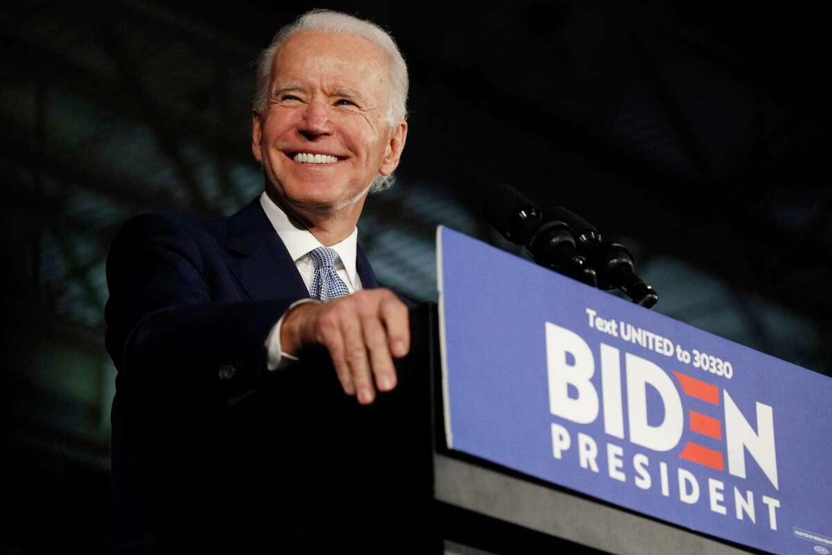 Former vice president Joe Biden smiles onstage after being declared the winner of the South Carolina primary on Saturday, Feb. 29, 2020.