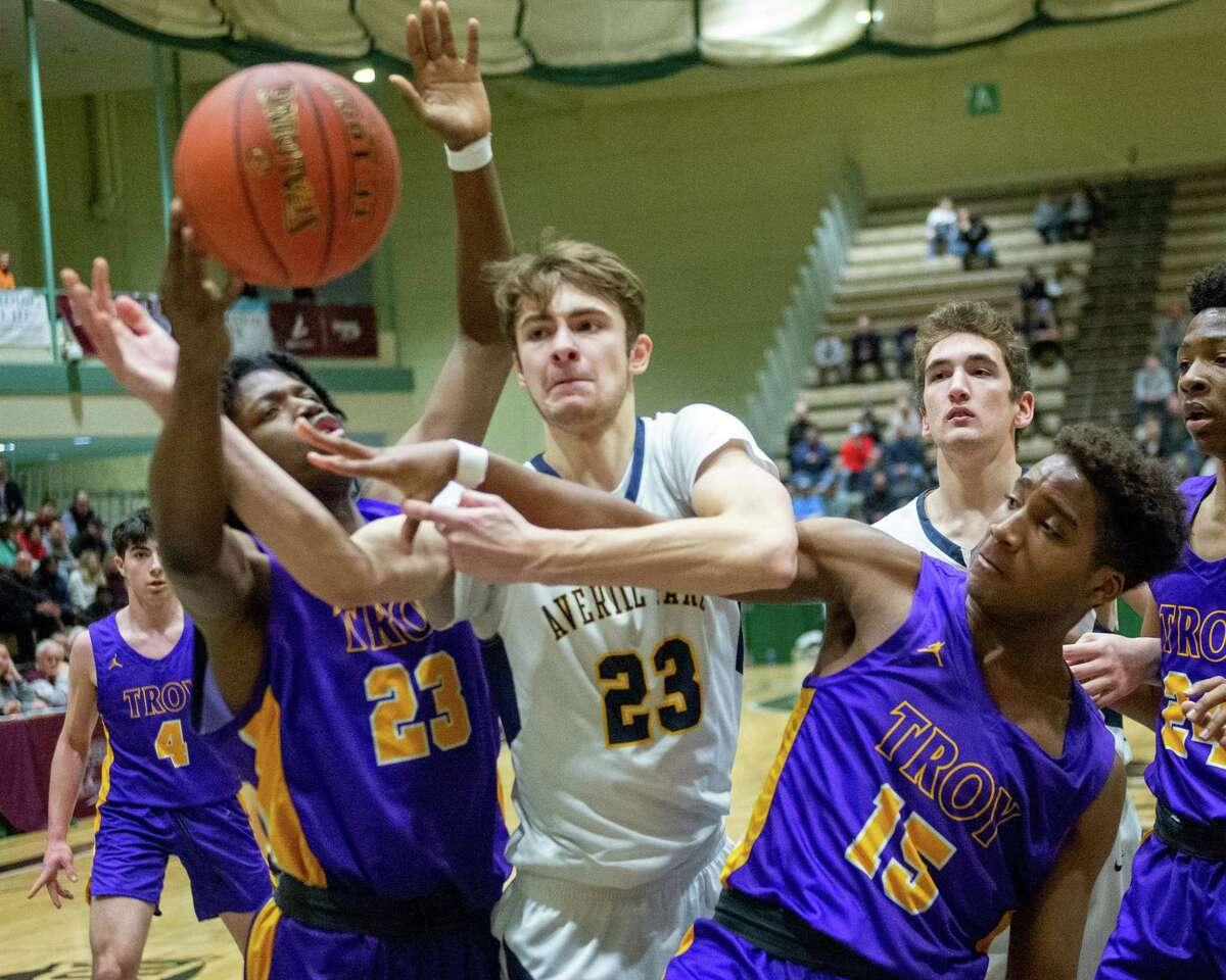 Averill Park junior Vinny Carucci fights for a rebound with Troy junior Shambo Caldwell (23) and junior Jadon Cummings during the Section II, Class A quarterfinals at Hudson Valley Community College in Troy, NY on Sunday, March 1, 2020 (Jim Franco/Special to the Times Union.)
