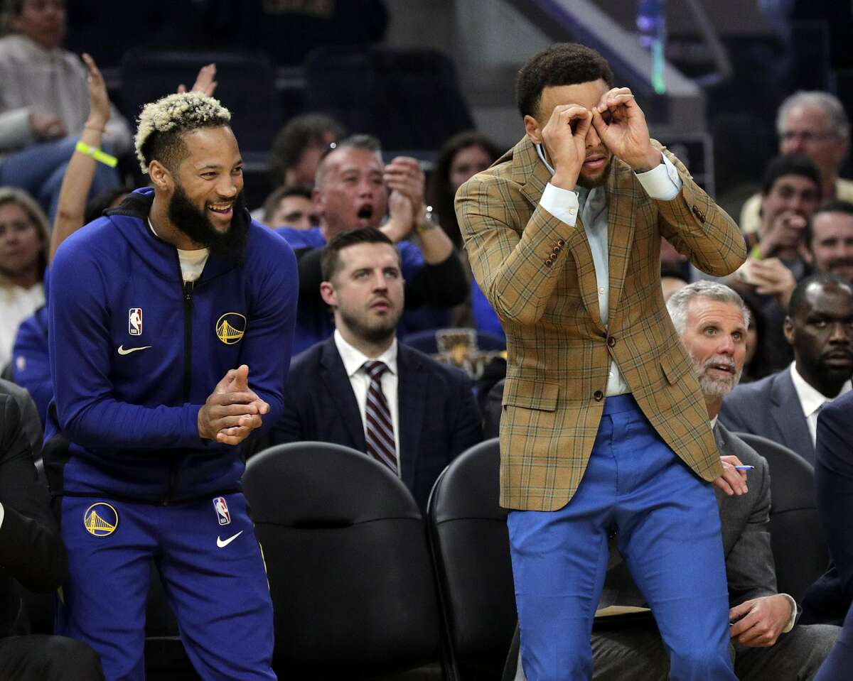 Stephen Curry (30) and Ky Bowman (12) cheer after a Warriors score in the first half as the Golden State Warriors played the Washington Wizards at Chase Center in San Francisco, Calif., on Sunday, March 1, 2020.