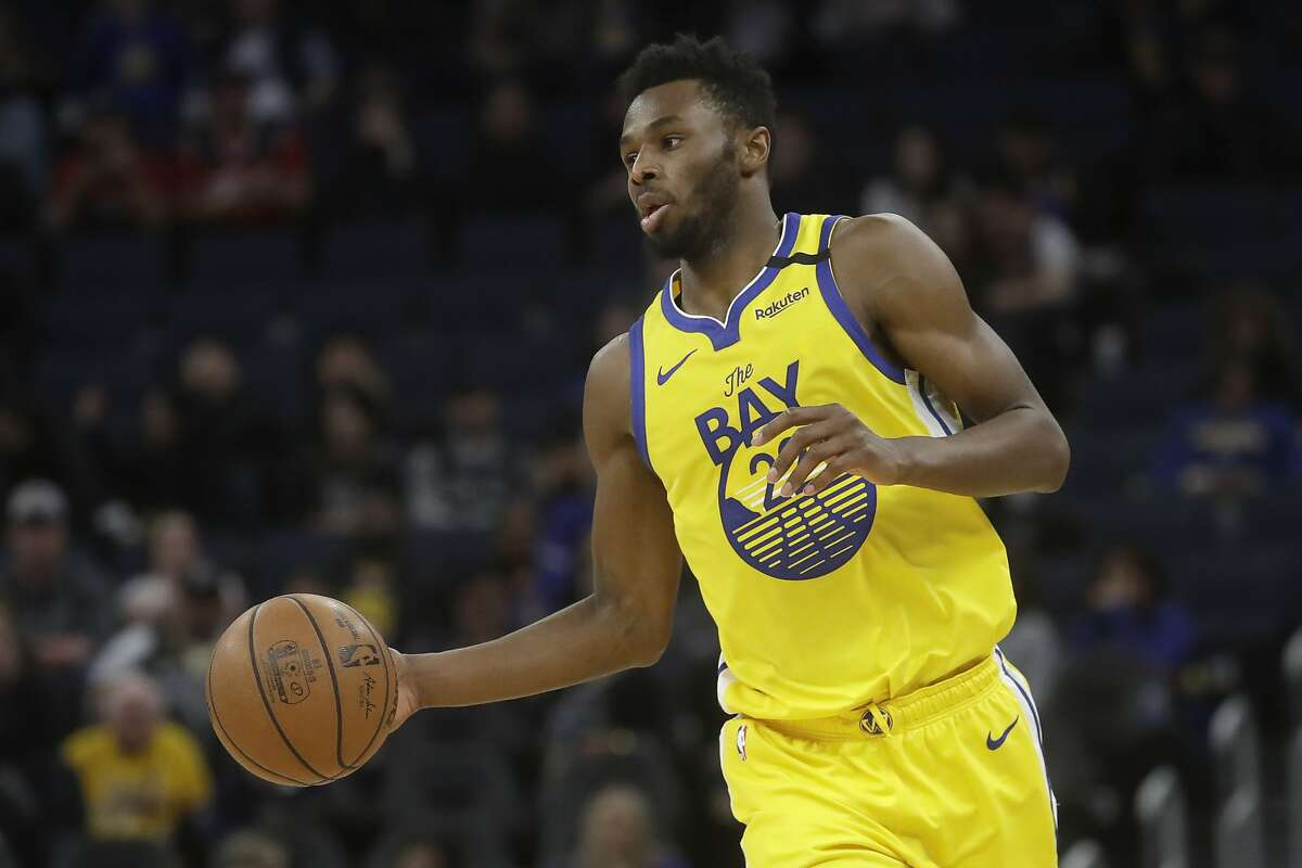 Golden State Warriors guard Andrew Wiggins (22) dribbles the ball up the court against the Washington Wizards during the second half of an NBA basketball game in San Francisco, Sunday, March 1, 2020. (AP Photo/Jeff Chiu)
