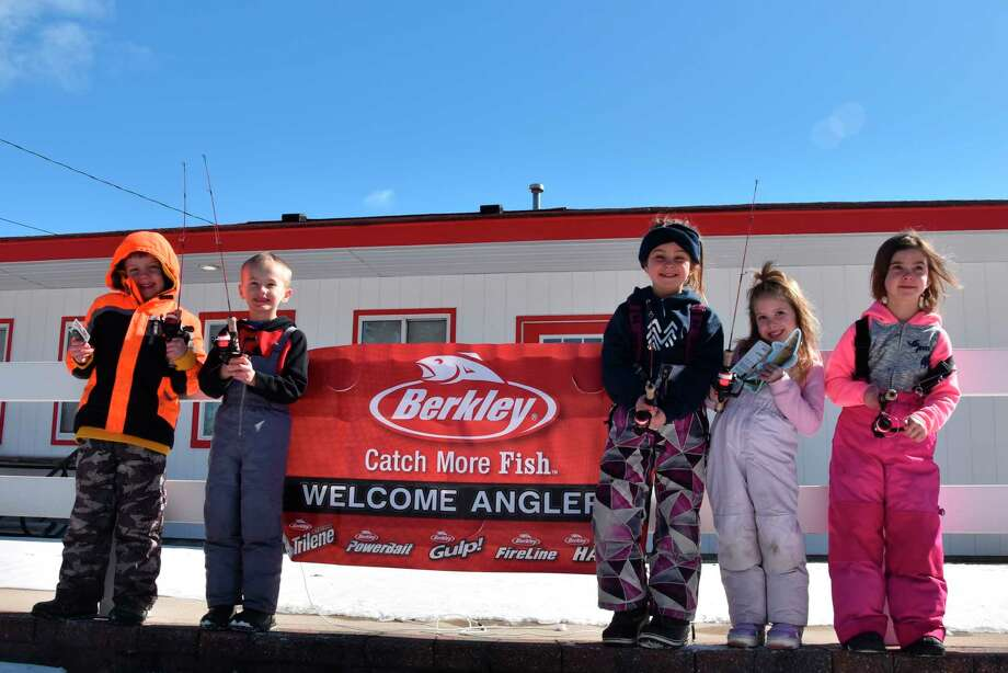 (From left) Abram Gannon, John Traeger, Julia Noury, Lilah Garber and Laura-Maude Noury each won prizes during thePortage Lake Ice Fun Fish event Saturday. Manistee County Sport Fishing Association hosted the event. (Arielle Breen/News Advocate)