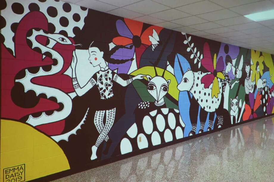 One of many mural works done by artist Emma Daisy Gertel, who has been commissioned to create a mural on the wall of the JC Penney store downtown. (Pioneer photo/Cathie Crew)