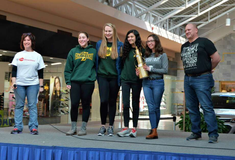 The Dow High School team took home a trophy for first place in the people's choice award, as part of the Canstruction Midland event on Saturday, Feb. 29, at the Midland Mall. (Ashley Schafer/Ashley.Schafer@hearstnp.com)