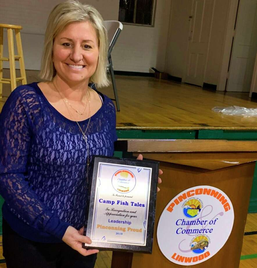 Shannon Forshee, executive director at Camp Fish Tales, accepts a Leadership Award from thePinconning and Linwood Area Chamber of Commerce. (Photo provided)