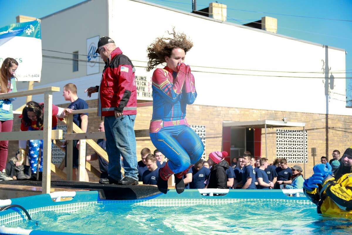 The Polar Plunge on Saturday in downtown Big Rapids drew large crowds of plungers and spectators.