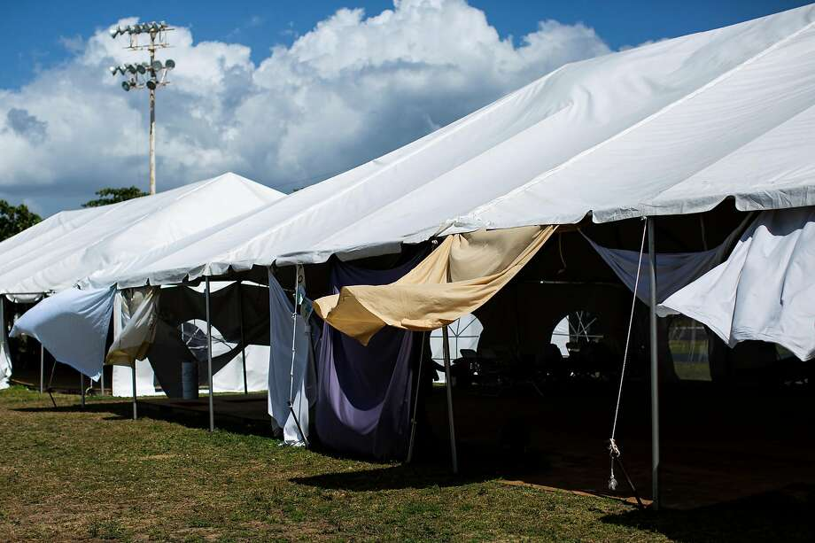 Tents used to house people at a government shelter in Guánica, Puerto Rico, on Feb. 12. Nearly two months after an earthquake,  thousands  still  spend each night  in their cars and open tents. Photo: Erika P. Rodriguez / New York Times