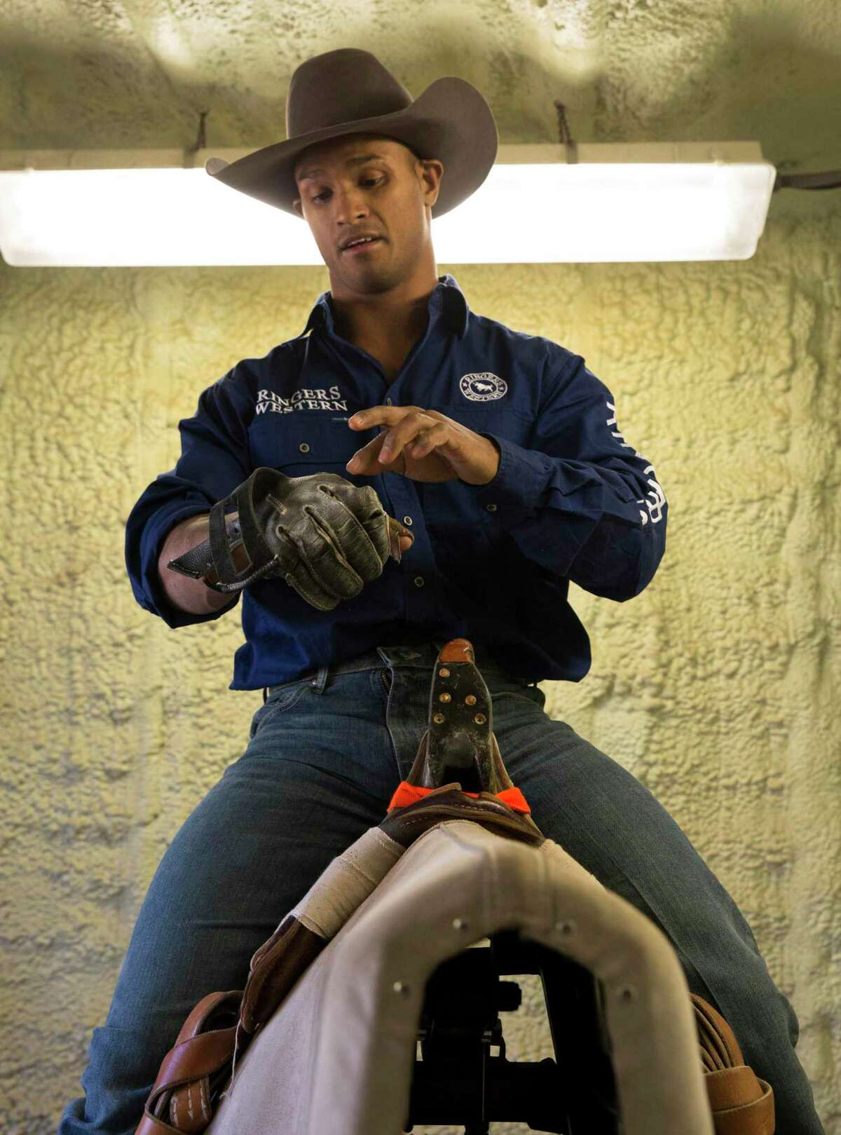 Bareback rider Anthony Thomas, an Australian native, practices with a bucking machine Thursday, Feb. 27, 2020, at Humble Hairpin Ranch in Humble. Thomas had go to rehab at Memorial Hermann Ironman Sports Medicine Institute to heal torn ligaments in his arm from years of bareback riding.