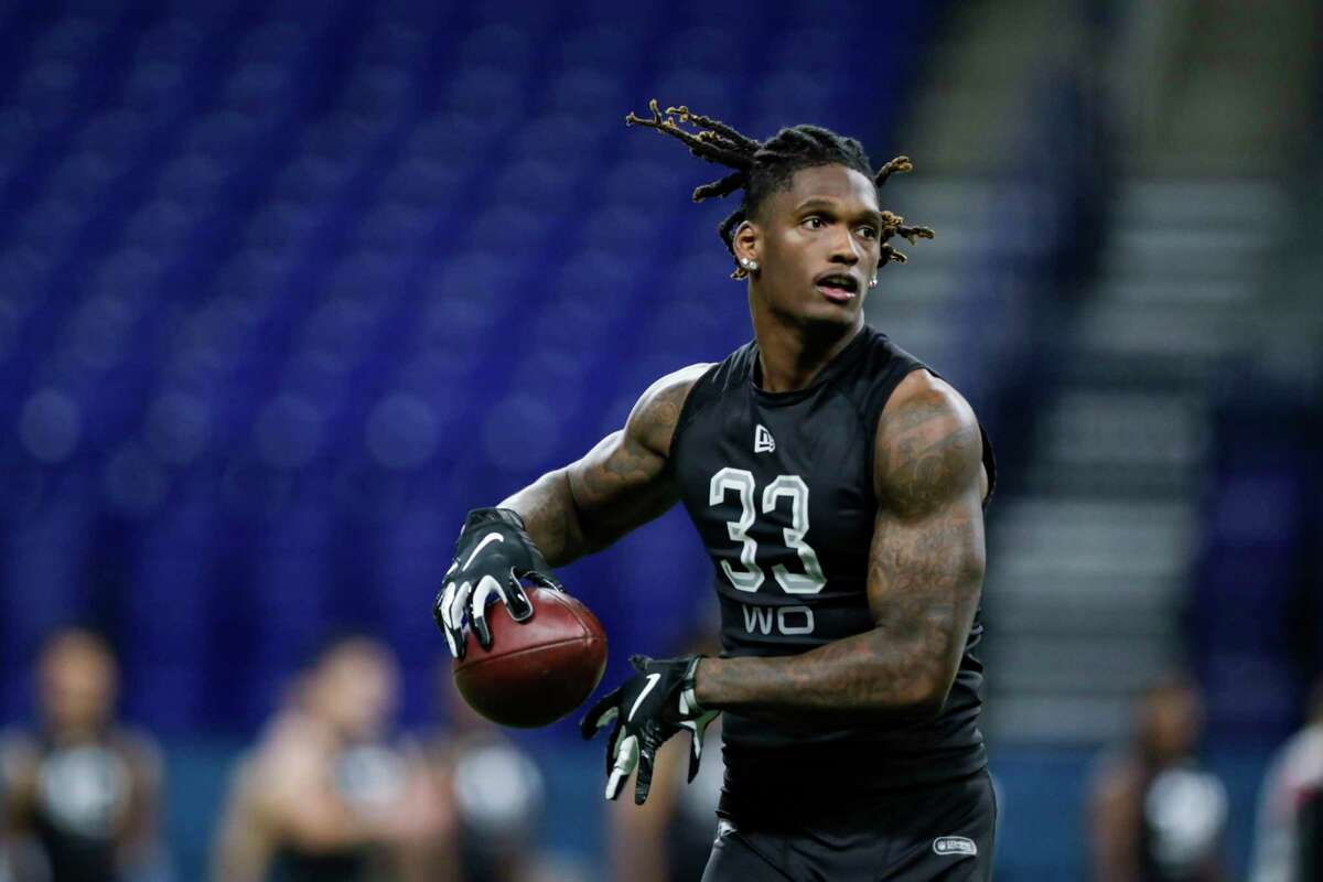 Oklahoma wide receiver Ceedee Lamb runs a drill at the NFL football scouting combine in Indianapolis, Thursday, Feb. 27, 2020.