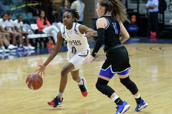 Raven Adams (0) of Ridge Point drives around Kylie Minter (5) of Clear Springs during the first quarter of a Girls 6A Region III semifinal play-off game between the Ridge Point Panthers and the Clear Springs Chargers on Friday, February 28, 2020 at the Leonard Merrell Center, Katy, TX.