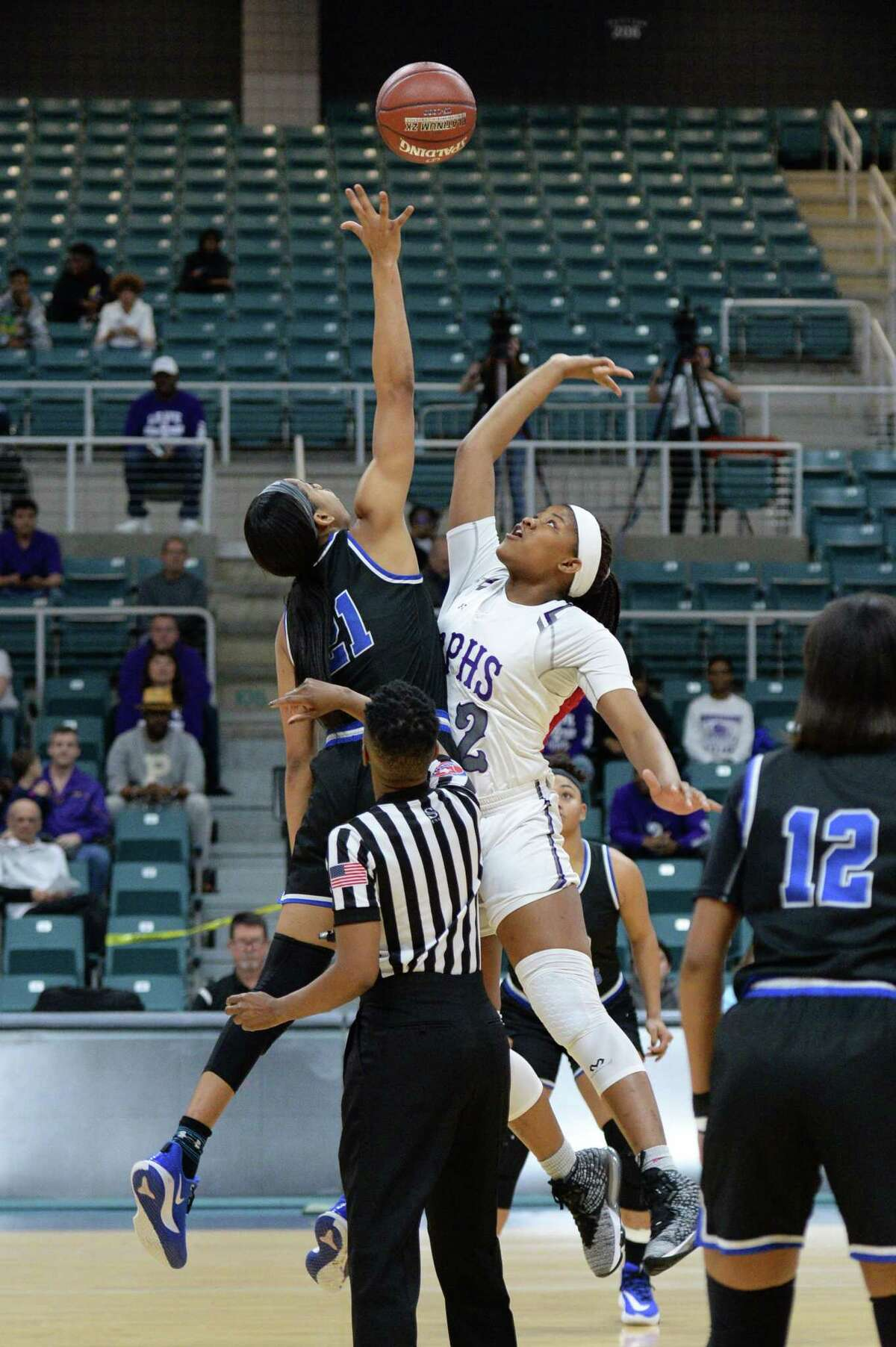 Dala Allen (32) of Ridge Point and Niyah Johnson (21) of Clear Springs compete for the tipoff to start a Girls 6A Region III semifinal play-off game between the Ridge Point Panthers and the Clear Springs Chargers on Friday, February 28, 2020 at the Leonard Merrell Center, Katy, TX.