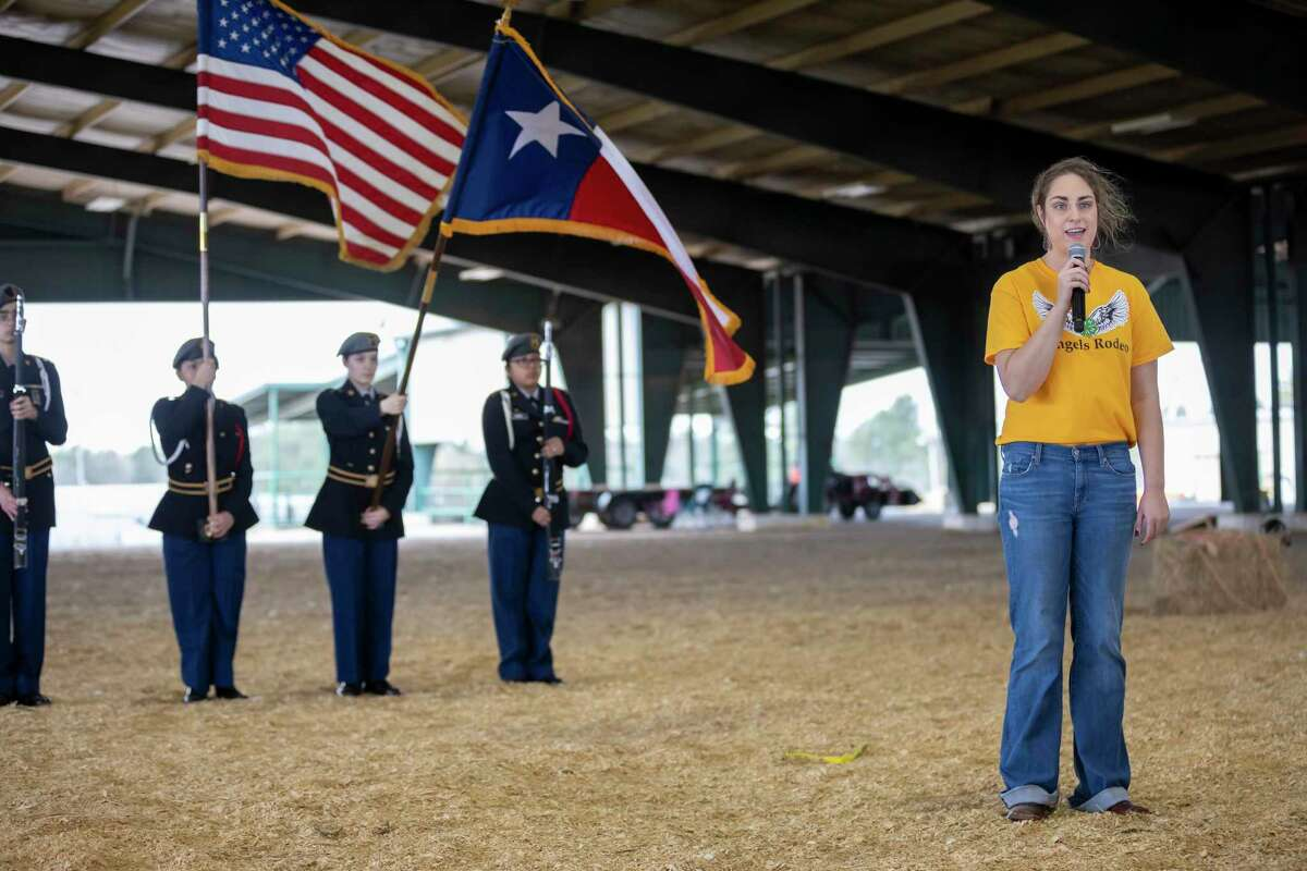 Lauren Holtkamp sings the national during Angel's Rodeo at the Montgomery County Fairgrounds Equestrian Center, Sunday, March 1, 2020.