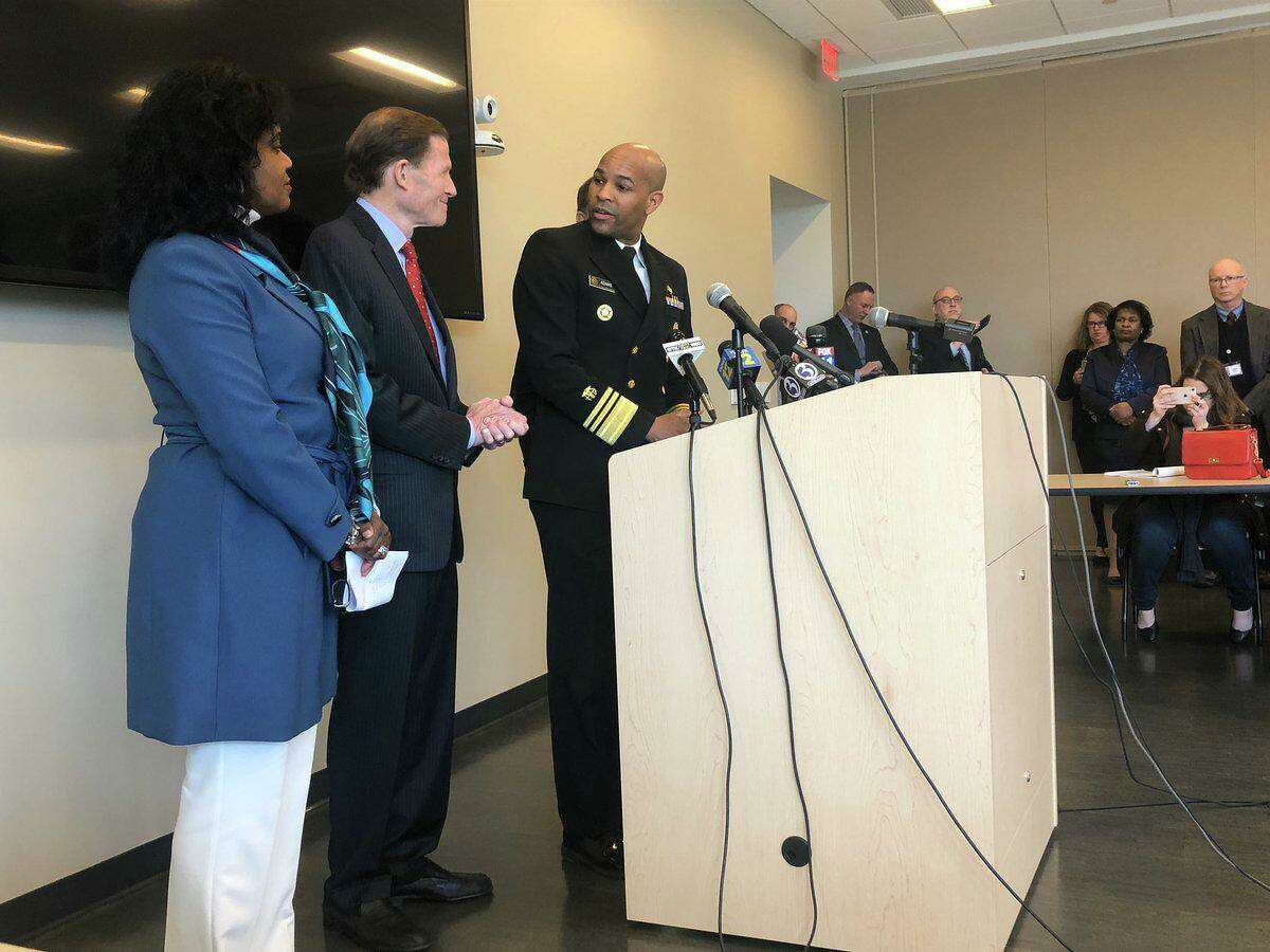 U.S. Surgeon General Vice Admiral Jerome M. Adams with Sen. Richard Blumenthal, Gov. Ned Lamont and DPH Commissioner Renée D. Coleman Mitchell discussing coronavirus preparedness at the state lab, which was approved last week to test for the virus.