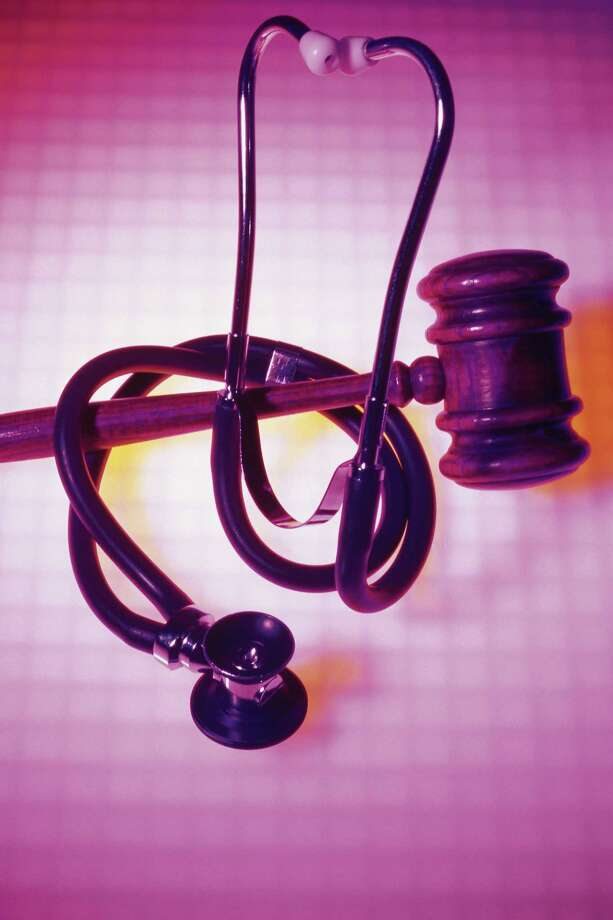 Stethoscope wrapped around gavel Photo: Comstock / Getty Images / Comstock Images / Comstock Images