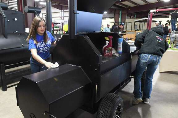 Maigyn Ellis, left, and Paige Paetzold, from the Vega (Texas) FFA chapter, clean their reverse-flow barbecue grill as part of the Junior Agricultural Mechanics Show at the San Antonio Stock Show & Rodeo. Teens from throughout the state entered grills, smokers, rotisserie units and other items.