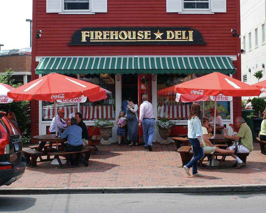 A 1912 image of the old Reef Road firehouse morphs into its present-day form as the Firehouse Deli, above, through the time-machine effect of Miggs Burroughs' lenticular photograph. An exhibit of Burroughs work opens at the Fairfield Museum and History Center Dec. 19. Photo: Contributed Photo / Contributed Photo / Fairfield Citizen contributed