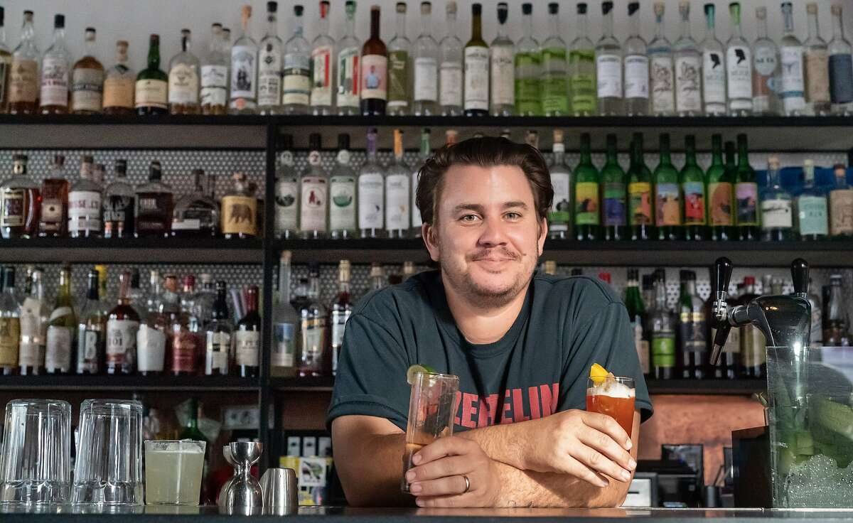 David Ruiz, the owner of Junior Bar, poses on Friday, Feb. 28, 2020, in San Francisco, Calif. Ruiz is among the rising number of Latin-American bar owners in the city.