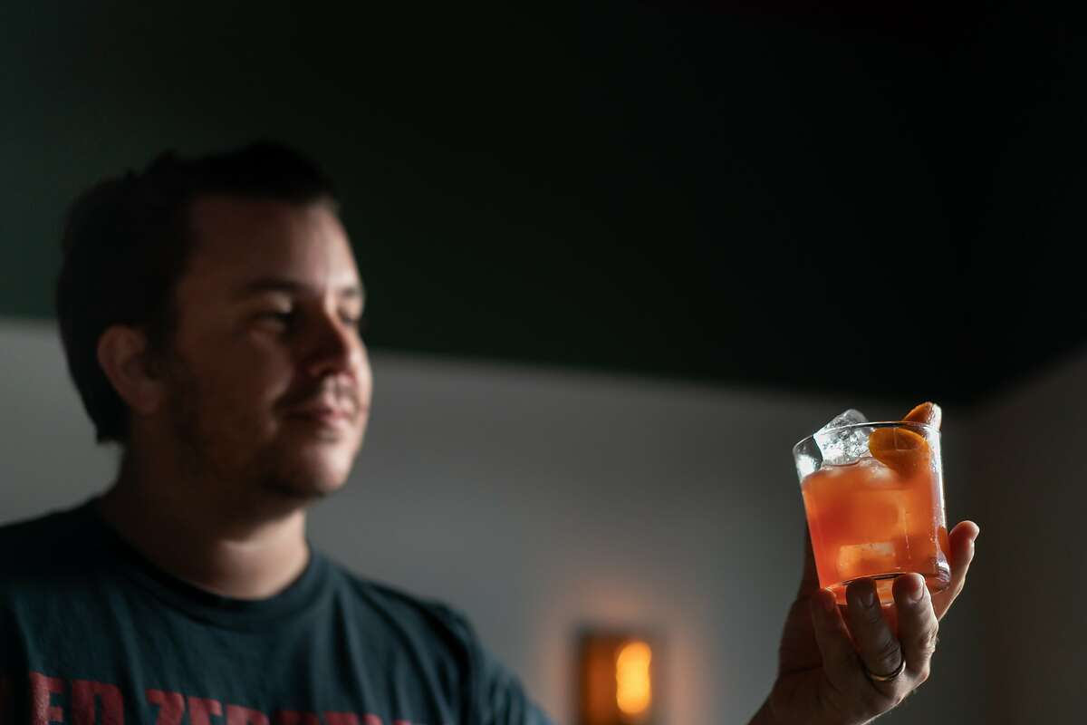 David Ruiz, the owner of Junior Bar, one of the increasingly Latin-American owned bars in San Francisco, holds a �Hat in the ring,� gin, pink grapefruit, bitter amaro, and lemon, on Friday, Feb. 28, 2020, in San Francisco, Calif.