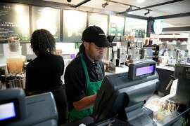 Jay Kelly, a Starbucks barista, works at the Orlando International Airport in Orlando, Fla., Feb. 26, 2020. A union representing employees at airport Starbucks locations says immigrant, transgender and black baristas have faced discrimination. (Phelan M. Ebenhack/The New York Times)