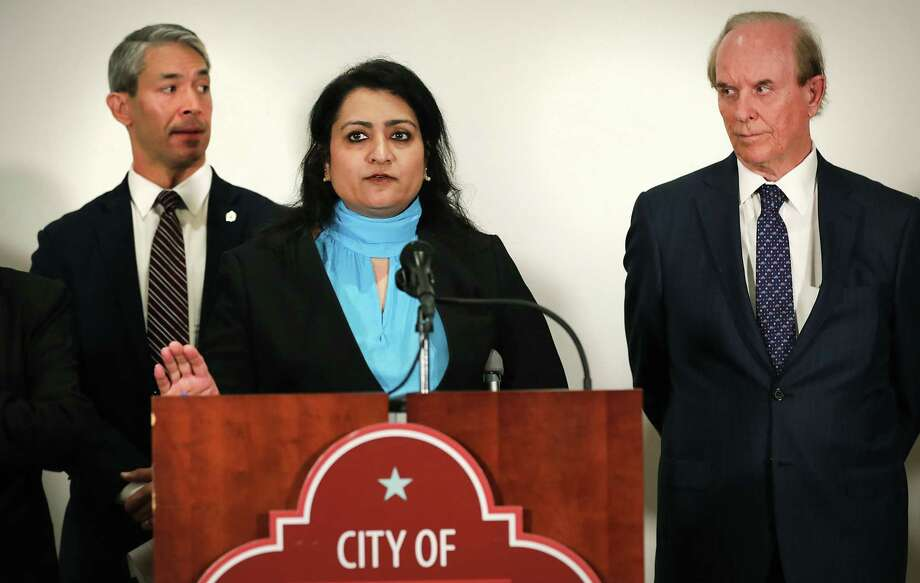 Mayor Ron Nirenberg, left, and County Judge Nelson Wolff, right, listen to Anita Kurian, assistant director of San Antonio Metropolitan Health overseeing the communicable disease division, at a news conference on March 2 at Plaza de Armas during the early days of the novel coronavirus pandemic. Daily briefings with Nirenberg and Wolff have continued; Kurian is a frequent guest. The briefings can be seen live at 6:13 p.m. every day at www.facebook.com/cosagov Photo: Bob Owen /San Antonio Express-News / San Antonio Express-News