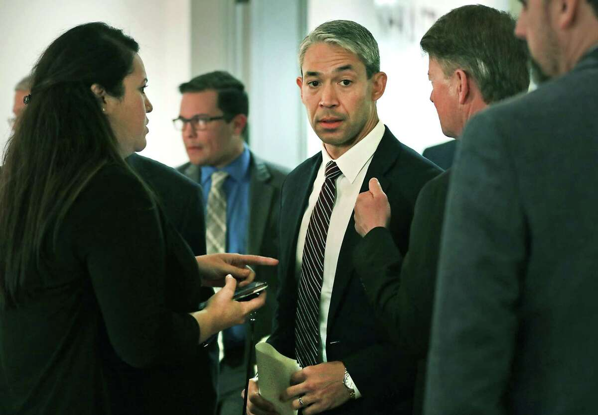 Mayor Ron Nirenberg, center, confers with members of his staff as city leaders and local public health officials discuss recent updates on the coronavirus evacuees in San Antonio on Monday, March 2, 2020, at Plaza de Armas.