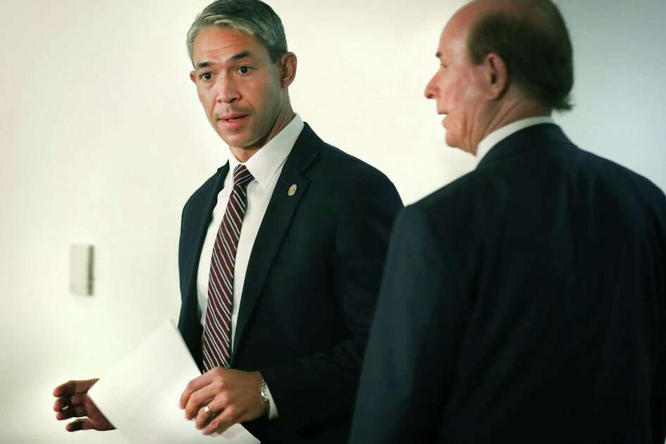 A virtual town hall meeting Tuesday answered questions posed by residents and businesses about the stay-at-home order issued earlier this week by Mayor Ron Nirenberg, left, and County Judge Nelson Wolff that took effect at 11:59 p.m. Tuesday.