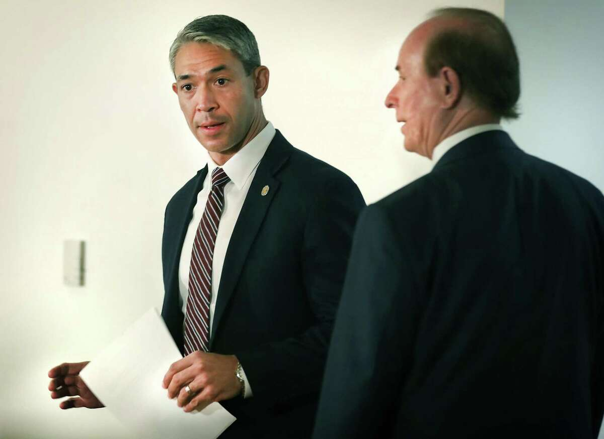 Mayor Ron Nirenberg and County Judge Nelson Wolff prepare to address the media during a March news conference. On Monday, they said government leaders are working to craft a local new order that allows residents to patronize reopened businesses but still requires them to stay home and prevent the spread COVID-19, the disease caused by the coronavirus.