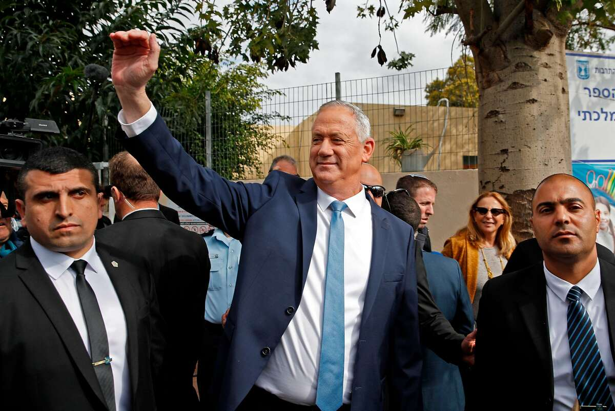 Israeli centrist Blue and White party, and ex-military chief Benny Gantz waves outside a polling station in the city of Rosh Hayin during parliamentary election on March 2, 2020. - Israelis were voting for a third time in 12 months today, with embattled Prime Minister Benjamin Netanyahu seeking to end the country's political crisis and save his career. (Photo by Jack GUEZ / AFP) (Photo by JACK GUEZ/AFP via Getty Images)
