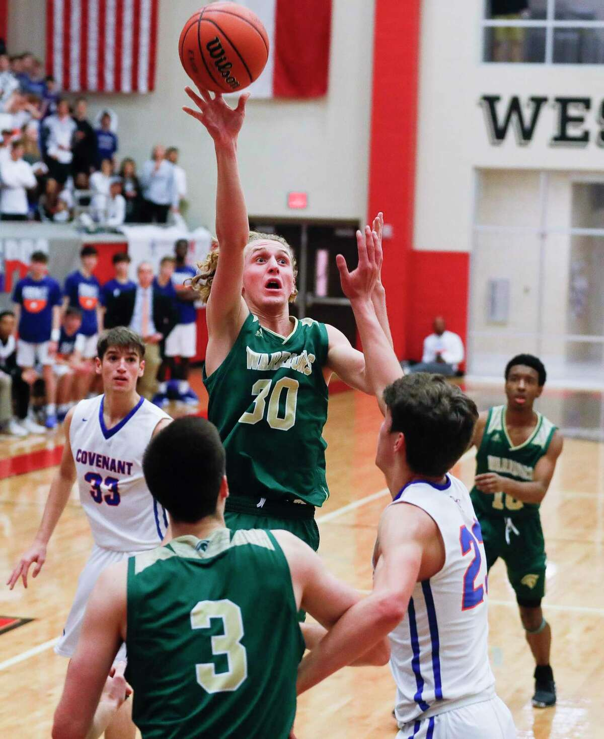 The Woodlands Christian Academy guard Luke Mansfield (30) shoots a floater during the third quarter of the TAPPS Class 4A high school basketball championship at West High School, Saturday, Feb. 29, 2020, in West.