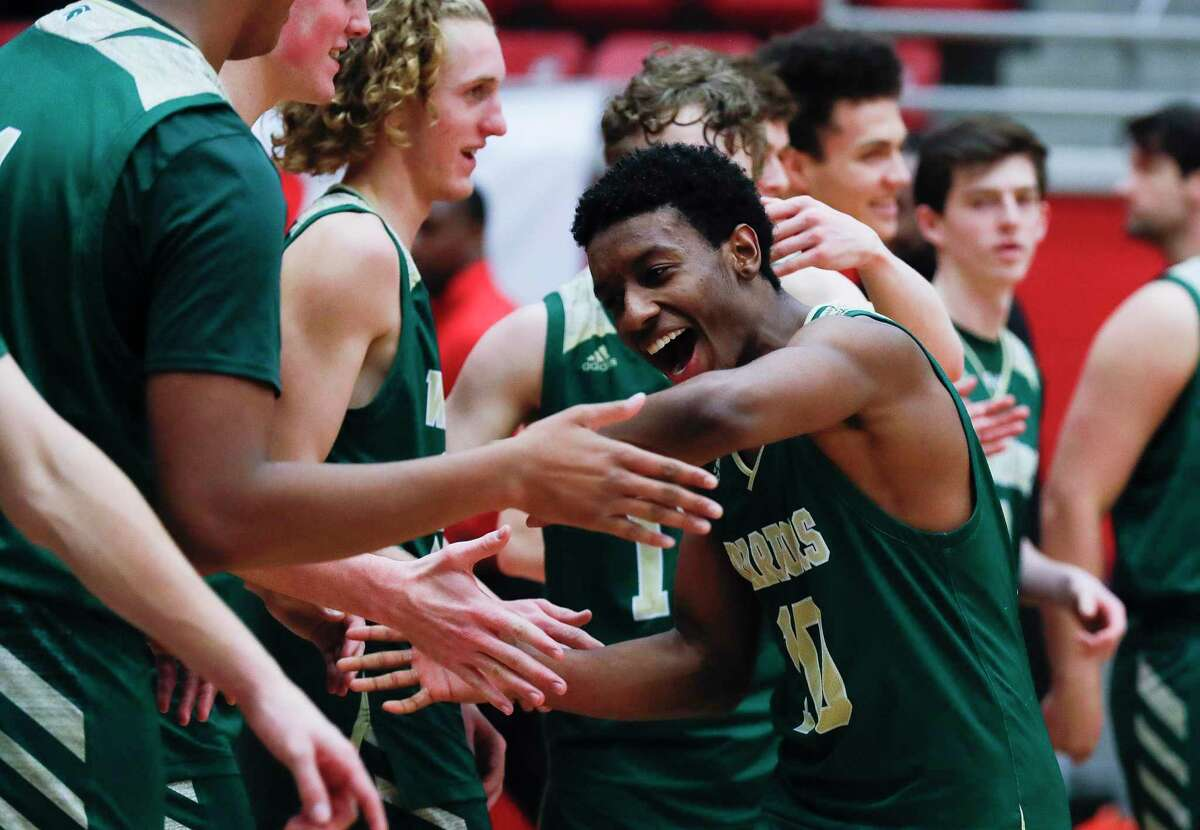 The Woodlands Christian Academy point guard Bakari LaStrap (10) reacts with teammates after the Warriors won their second title in three years with a 68-50 victory over Colleyville Covenant Christian during the TAPPS Class 4A high school basketball championship at West High School, Saturday, Feb. 29, 2020, in West.
